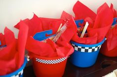 Race track theme birthday favors - buckets containing Hot Wheels, light sticks and bubbles. What else does a 3yr old want?