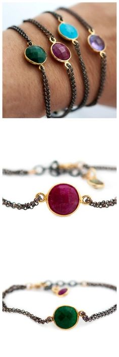 A natural faceted Ruby is bezel set in 18k gold vermeil and attached to an oxidized double sterling silver chain. The bracelet has an extention and measures from 6 inches to 7 inches. It is finished o