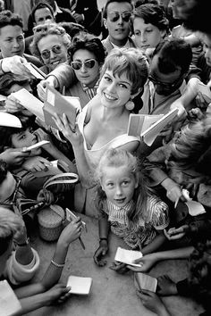 Brigitte Bardot and child star Brigitte Fossey signing autographs at the Cannes film festival 1955