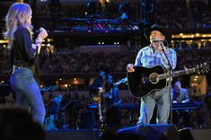 "Musicians Faith Hill (L) performs ""A Showman's Life"" and ""Let's Fall To Pieces Together"" onstage with George Strait (R) at George Strait's 'The Cowboy Rides Away Tour' final stop at AT"