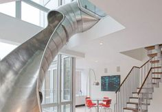 Looking for a new way to get from one floor of your duplex penthouse apartment to the other, why not include a slide? How fun would that be! Duplex Apartment, Apartment Interior Design, Loft Apartments, Apartment Renovation, Stair Slide, House Slide, Indoor Slides, Contemporary Family Rooms, Escalier Design