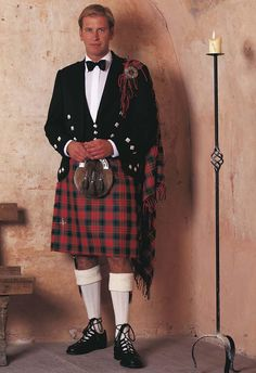 Traditional Highland formal wear. The kilt and Plaid were originally one piece of cloth 6m long and held together with a belt and broach.