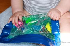 Ziplock Freezer Bag, Coloured Green Hair Gel, Duct Tape, Frogs, Buttons, Beads, Silly Bands, Flat Marbles
