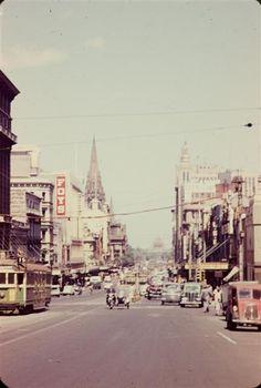 View of Swanston Street from Latrobe Street, Melbourne, Australia, 1957. Photographed by Marlene Austin.