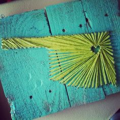 I love this state string art on the painted wood.