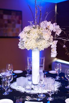 tall white centerpieces    www.facebook.com/NaturalSimplicityFlowers