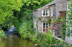 Old English Cottage On River