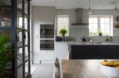 The space has been opened up from two smaller rooms to create a spacious kitchen-dining room.