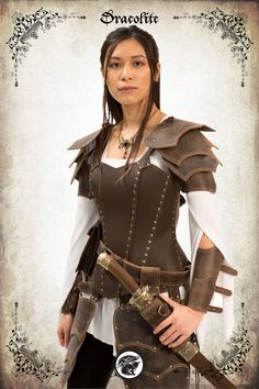 Damiane adventurer woman armor set for LARP made by our team at Dracolite. Imagined and created by our leather team  To make sure your armor fits perfectly, please send us the following mesurements:  Bust: Waist: Hips: Forearm: Wrist:   Details : * 100% original and unique design * Handmade by our leather team * High quality leather * Custom leather colouring, engraving and molding handcrafted by Dracolite * This item can be personalized on request (contact us) * Made in Canada  Ideal for…