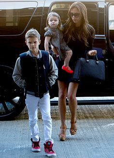 """Victoria Beckham (with daughter Harper and son Brooklyn) looked chic as ever outside Los Angeles International Airport April that was us magazine. The moment you realise thats not Brooklyn. David Et Victoria Beckham, Victoria And David, Victoria Beckham Style, David Beckham, Celebrity Gallery, Celebrity Moms, Posh And Becks, The Beckham Family, Harper Beckham"
