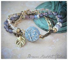 Multistrand lavender butterfly bracelet