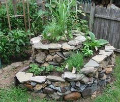 Great idea, a terraced herb wheel! High and dry herbs below, those needing more water and/or shade below. Brilliant!