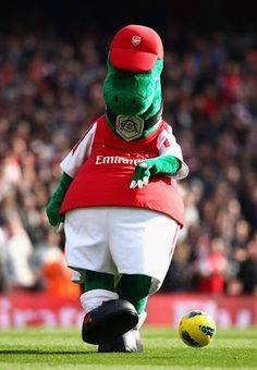 Gunnersaurus Rex is the Arsenal Football Club Mascot. Acording to Arsenal FC websites Gunnersaurus Rex was born in North Bank, Highbury,. Arsenal Fc, Arsenal Football Team, Sport Football, Football Fans, Arsenal Pictures, Arsenal Wallpapers, Sports Advertising, Helmet Logo, Sports Shops