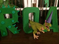 Wooden letter decorations at a dinosaur birthday party! See more party planning ideas at CatchMyParty.com!