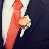 Orange tie black suit