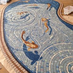 "garydrostle: "" The new fishpond mosaic completed and ready for installation #mosaics """