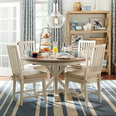 Features:  -Hardwood solids and oak verneers..  -Dust with a clean, dry cloth..  -Chairs not included.  Top Finish: -Terrace Gray.  Base Finish: -Washed Linen.  Distressed: -Yes.  Top Material: -Wood.