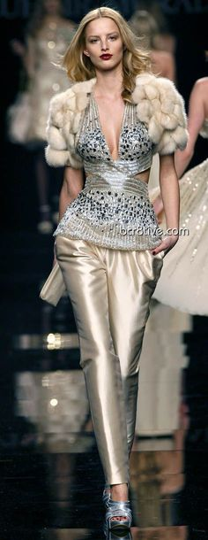 paneled top ....hip length... paired with pencil floor length skirt and full trained skirt. Zuhair Murad fall winter 2009 Ready to wear collection