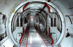 Corridor inside a toroidal space station by Sam Brown.  #Torus  #SpaceStation  #SamBrown