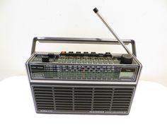http://www.ebay.com/itm/VINTAGE-OLD-TELEFUNKEN-PARTNER-INTERNATIONAL101-NEAR-MINT-MID-CENTURY-TUBE-RADIO/141989325131?_trksid=p2047675.c100009.m1982