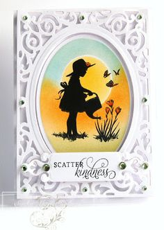 handmade card ... lacy die cut frame with oval focal point ... silhouette of girl watering flowers ... bright sponged background .... luv it!!