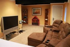 Home #theatre in #basement with flat TV #modern media room