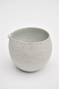 """Speckled grey, porcelain and stoneware mix jug. Inside of the jug is glazed. Suitable for everyday use. Dishwasher safe. Approx H4"""" x D3    Sue Paraskeva works from her studio on the Isle of Wight, where throwing porcelain on a momentum wheel and reduction firing in a gas kiln are fundamental to the creation of her work during the last 16 years."""