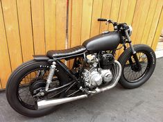 This super clean and lean 'Brat Styled' CB400 was built by Jared Johnsonand Joe Carlinofrom the newly formed Holiday Customs. The project started when Joe purchased a beat up old 1975 Honda C...