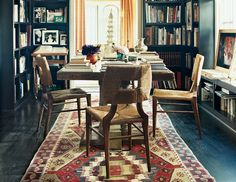 dining room apartment decorating ideas  on domino.com This wonderful room is for ding and also serves as a library. Note the wonderful blue walls and floor.