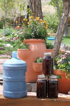 Camp Wander: Please Don't Drink the Sweet Manure Tea!  A great photo tutorial on making manure tea for the garden...easy enough for me to do.