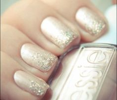 Glam Glitter Nails: Fairy Pretty. Pick a metallic pinky-nude shade as a base coast then top it with silver glitter polish, creating a more opaque look at the tip of your nail.