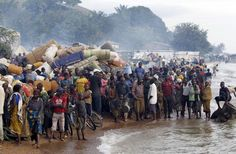 Burundian refugees gather on the shores of Lake Tanganyika in Kagunga village in Kigoma region in western Tanzania, as they wait for MV Liemba to transport them to Kigoma township, May 17, 2015. Burundi President Pierre Nkurunziza on Sunday made his first public appearance in the capital Bujumbura since an attempted coup last week failed to oust him from power, saying he was monitoring a threat posed by Islamist militants from...