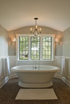 If I liked tubs, I'd like this. Like the overall feeling, the floor, wainscoting and curved ceiling. Walls are a nice color, but I would replace wallpaper with paint. Bigger chandelier too!