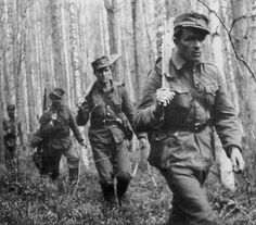 Elite Finnish Jaegers patrol through a forest during the Continuation War.