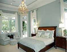 Gorgeous master suite!  Blue & white color scheme with cherry furniture!