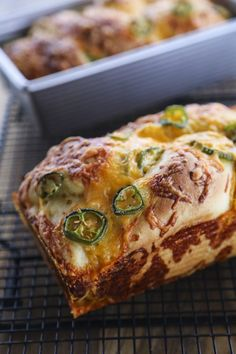 Jalapeno Cheddar Bread: tender sandwich bread studded with fresh jalapeno slices and lovely melted cheddar cheese with a thick cap of toasted cheddar on top. Just like Wegman's bakery bread!
