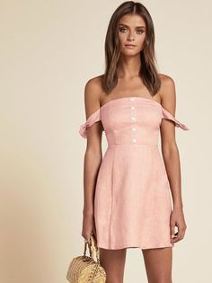 Like Positano in dress form. This is an off-the-shoulder, fit and flare dress with arm ties and center back zipper.