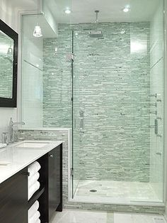 Seamless glass enclosure For single shower. Resurface tile if dated. Light Gray is nice. Install simple ikea cabinet & sink and same toilet.
