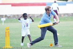 Howzat Harry! The prince whacks a ball out to the boundary as a fielder looks on at the Sir Viv Richards Stadium on Antigua