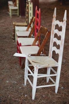 a ceremony filled with mixed vintage chairs Photography by Kristyn Hogan / kristynhogan.com, Floral   Event Design by Cedarwood Weddings / cedarwoodweddings.com