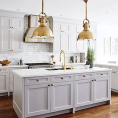 Loving @allisonwillson's gray kitchen accentuated with brass accents, don't you? via: @houseandhomemag | Via Instagram: @scoutandnimble