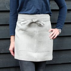 Short linen apron, like this simple guy for front of house team. For bakers, they'll obviously want full apron I'd think.