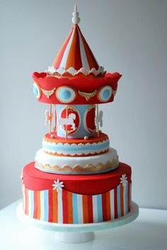 Carousel Cake by Sweet Temptations – Custom Cakes by Albena for a baby shower. All parts of the cake are edible.