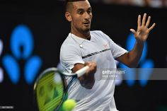Nick Kyrgios of Australia hits a return against Gastao Elias of Portugal during their men's singles first round match on day one of the Australian Open tennis tournament in Melbourne on January 16, 2017.  / AFP / PAUL CROCK / --IMAGE RESTRICTED TO EDITORIAL USE - STRICTLY NO COMMERCIAL USE--        (Photo credit should read PAUL CROCK/AFP/Getty Images)