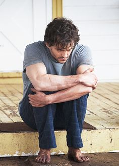 Will Graham, look at his cute little dirty feet and his depressed/ kicked puppy expression! Oh i just wanna squish his face in my hands!