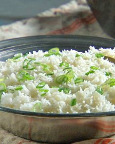 Rinsing rice in lukewarm water removes excess starch and prevents the rice from becoming gummy once cooked.
