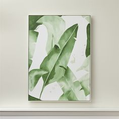 Shop Banana Leaf Print.  Allowing the white background to define the distinctive notched shape of banana leaves, artist Jessica Rowe blends and bleeds washes in rich green to add form and volume.
