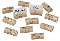 Cheap, easy place card holders you can make yourself! Just cut a wine cork in half so that the bottom will lay flat on the table and make a slit for the names & you're done!