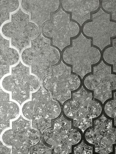 This beautiful Velvet Foil Trellis Wallpaper will bring a touch of glamour and style to any room. The design features a geometric trellis pattern in a gunmetal silver shade, overlaid on a seemingly abstract pattern of different subtle textures that work together to give the appearance of crushed velvet in the same gunmetal tone, with a high shine metallic foil finish. This paper is designed to catch and reflect the light to give you a different look depending on the viewing angle and… Metallic Wallpaper, Paper Wallpaper, Vinyl Wallpaper, Crushed Velvet Wallpaper, Trellis Wallpaper, Trellis Pattern, Subtle Textures, Abstract Pattern, Home Art
