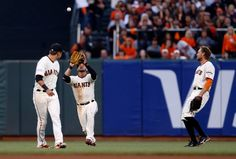 San Francisco Giants' Gregor Blanco (7) makes a catch in center field against the St. Louis Cardinals in the fourth inning of Game 5 of the National League baseball championship series in San Francisco, Calif., on Thursday, Oct. 16, 2014.  (Nhat V. Meyer/Bay Area News Group)